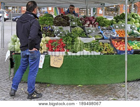 Man Is Selling Fruits And Vegetables Outdoor In Malmo, Sweden
