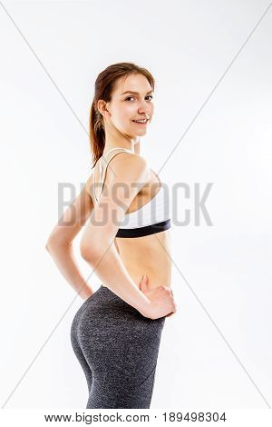 Photo of athlete in sportswear on white background