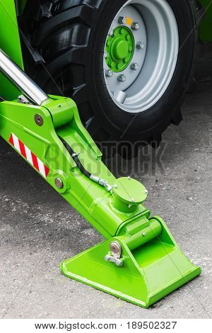 hydraulics crane support. hydraulics crane support is on gravel. focus on the hydraulics crane support