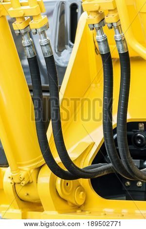 hydraulics pipes and nozzles, tractor or other construction equipment. focus on the hydraulic pipes