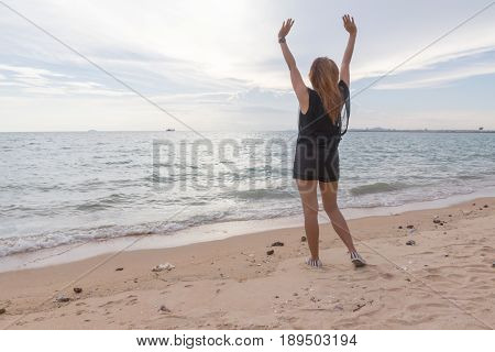 woman feel realx on the beach in weeken
