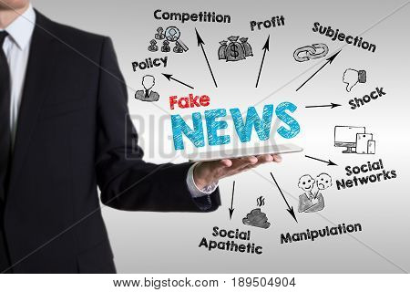 Fake News concept. Man holding a tablet computer.