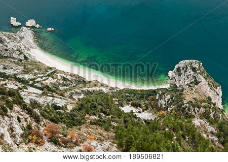 Beach of two sisters spiaggia delle due sorelle seen from the wolfs step in the park of Mount Conero Italy