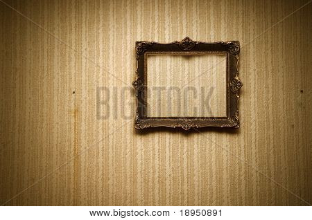 Old ornamented frame on retro grunge wall