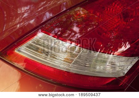 Car tail light with body orange-red color.
