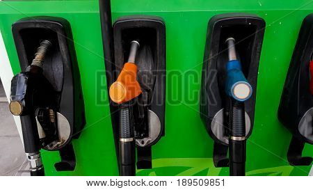 fill car with fuel and background .