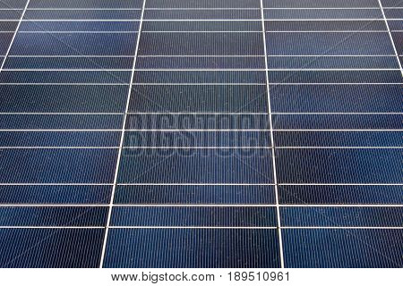Closeup of silicon solar photovoltaic blue panel with white grid