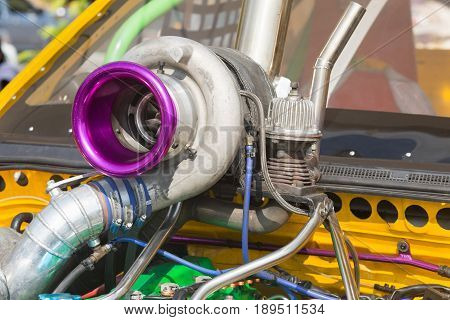 Turbocharged Diesel racing car engine in service pit