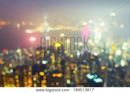 Blurred photo of hong kong city skyline at victoria peak view for background.
