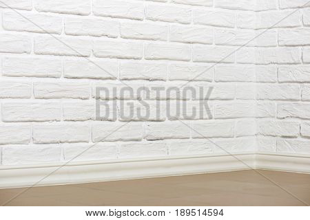 white brick wall with tiled floor and corner, abstract background photo