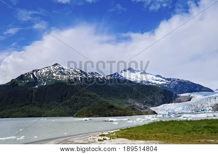 Mendenhall Glacier in Juneau Alaska with a blue sky