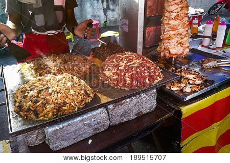 Person Grilling And Roasting Meat For Shawarma Pita Bread Meal