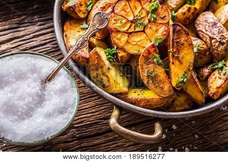 American potatoes. Baked potatoes in peel. Roasted potatoes with garlic spices salt cumin and herbs.