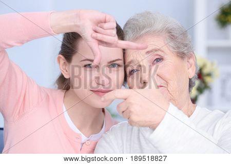 Grandmother and granddaughter, closeup