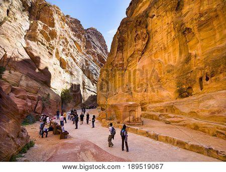 Petra Jordan - 9 March 2017: Tourists walking through the Siq canyon Petra Jordan