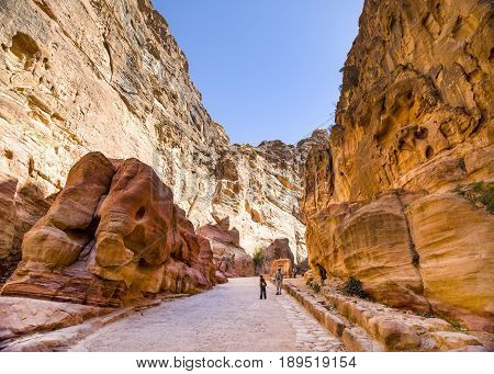 Petra Jordan - 9 March 2017: Tourists walking through the Siq canyon Petra Jordan