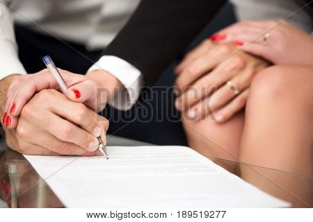 Man signing marriage settlement rich woman pulling into it