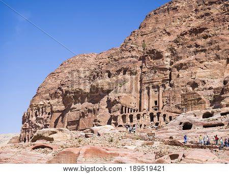 Petra Jordan - 9 March 2017: Tourists walking near the Urn Tomb Petra Jordan 9 March 2017