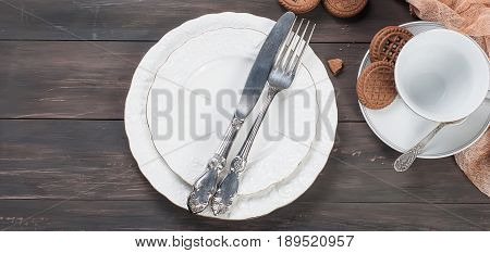 Empty Plates,fork,  Knife  And Cup On Wooden Table