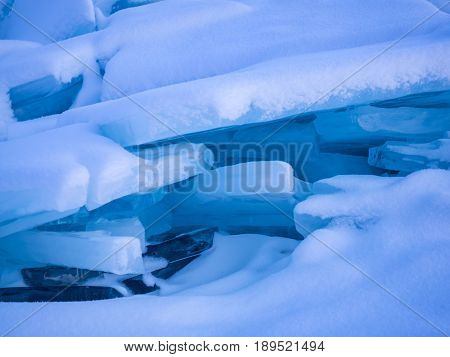 Ice blocks covered with snow at Frozen Lake Baikal Russia