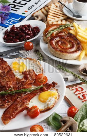 Substantial Irish breakfast with bacon, eggs and sausages