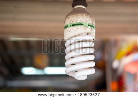 Close up of old economical energy saving spiral fluorescent lamp