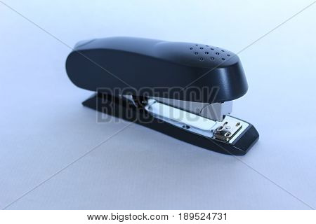 A professional black office stapler on a white background