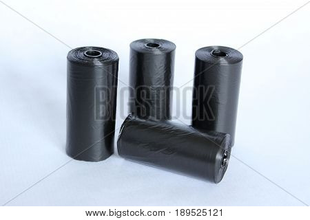 Rolls of black pouch for collecting canine droppings