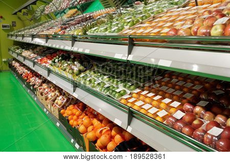Shelves with fruits in food supermarket, visible labels removed