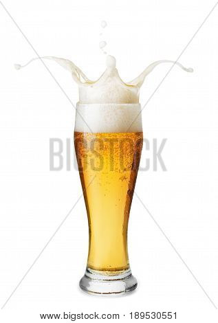 frosty glass of light beer with splashing foam isolated on white background. Glass with beer up. Beer splash