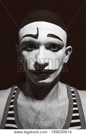 Portrait of a theatrical actor with a mime make-up on his face