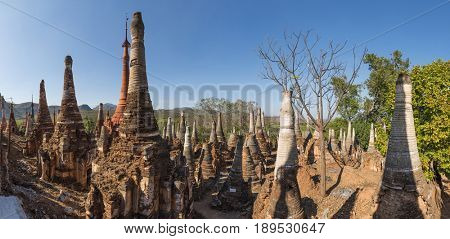 Many beautiful stone stupas hidden in a remote area of Myanmar across lake Inle neart the village of Indein. Panoramic picture
