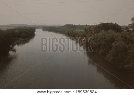Evening Tropical Landscape With A River