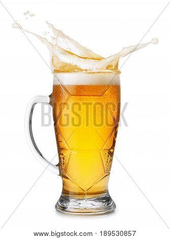mug of light beer with splashes of foam isolated on white background. Beer splash
