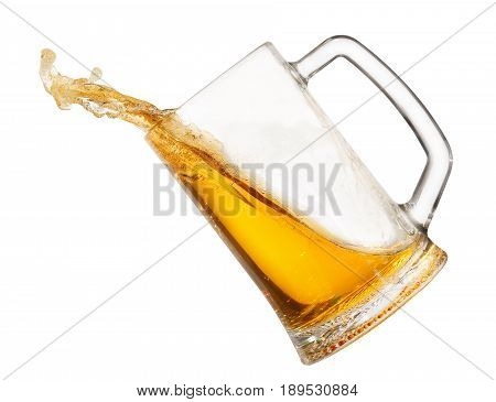 splashing beer in mug isolated on white background. Beer splash