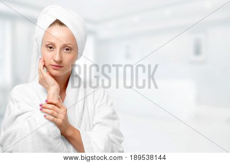 Beauty Portrait Of Woman Wearing A Towel And White Bathrobe