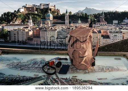Austria. Salzburg. Preparation For Travel, Tourism Mock Up Of Cell Phone, Backpack, Camera On The Ob