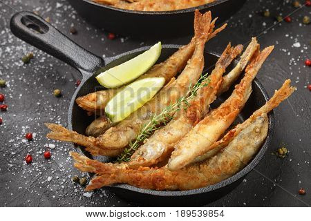 Fried Smelt In A Frying Pan On The Table With Spices, Lime And Thyme. Small Crispy Fish. Selective F