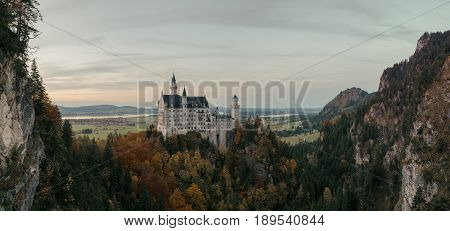 Beautiful view of world-famous Neuschwanstein Castle the 19th century Romanesque Revival palace built for King Ludwig II in beautiful evening light at sunset Fussen southwest Bavaria Germany