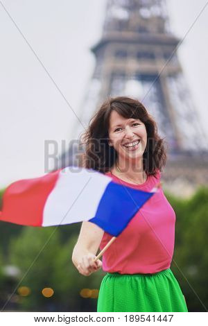 Cheerful Young Woman With French National Flag