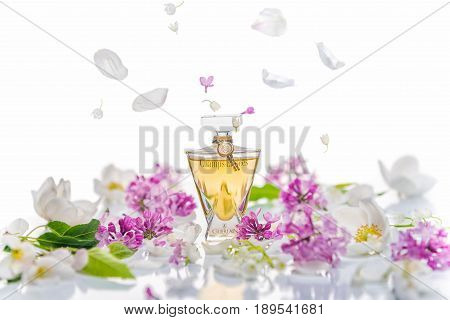 Saratov, Russia -  May 9, 2017: Champs Elysees Eau De Toilette Guerlain With Lilac Bush And Spring F