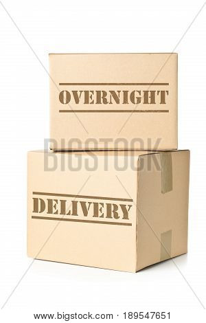 Two corrugated cardboard carton parcels with Overnight Delivery imprint