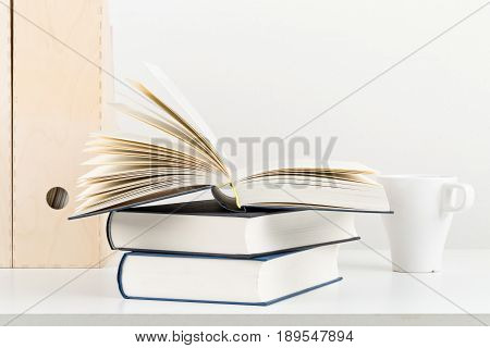 White office desk with books and folders - copy space - study or workplace background mock up