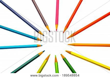 color pencils of different colors making a color wheel on white background