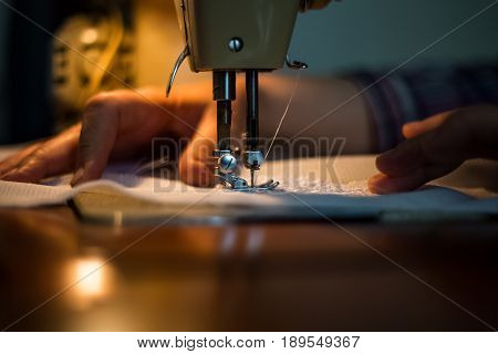 Sewing Machine, Sewing Process, Women's Hands Holding A Cloth To Sew, Connect With Another Piece Of