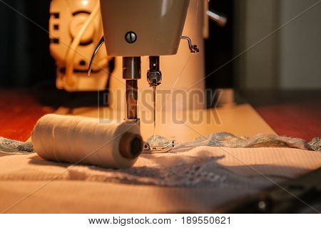 Sewing Machine, Sewing Process, Thread Next To Machines, Pause To Replace The Thread, Fabric Is Stit