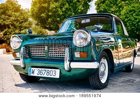 Villajoyosa Spain - May 28 2017: Triumph Herald car outdoors. It is a small two-door car introduced by the Standard-Triumph Company of Coventry in 1959