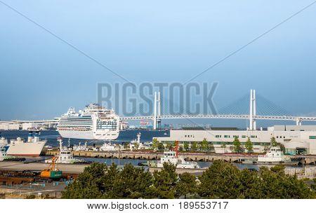 large passenger cruise ship is leaving Yokohama bay
