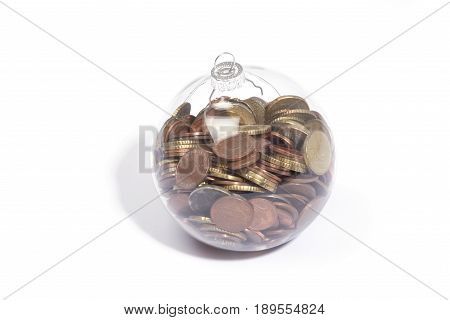 money coins in christmas ball isolated on a white background