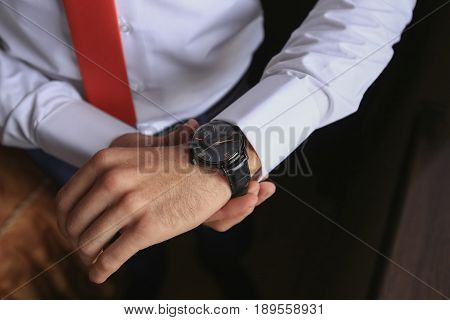 closeup fashion image of luxury watch on wrist of man. body detail of a business man. Man's hand.